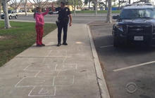 "Watch: Video of Officer ""Copscotch"" playing with homeless girl goes viral"