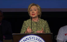 Clinton hits Sanders on guns, economy