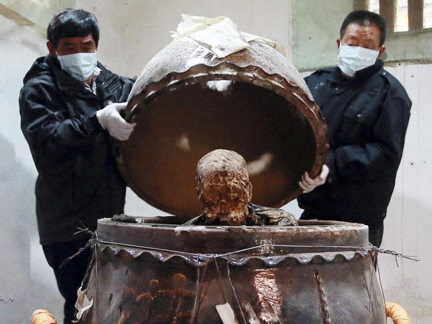 The mummified body of revered Buddhist monk Fu Hou, who died in 2012 at the age of 94, is revealed inside a large pottery jar in Quanzhou