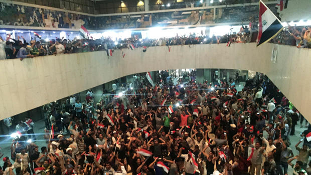 ​Followers of Iraq's Shiite cleric Muqtada al-Sadr are seen in the parliament building as they storm Baghdad's Green Zone after lawmakers failed to convene for a vote on overhauling the government in Iraq April 30, 2016.