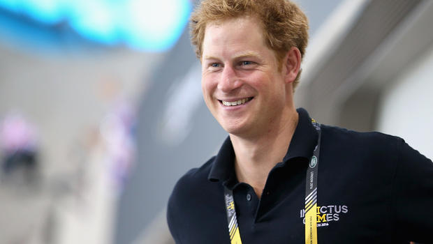 Prince Harry cheers swimmers at the Aquatics Centre during the Invictus Games at Queen Elizabeth Park on September 14, 2014 in London