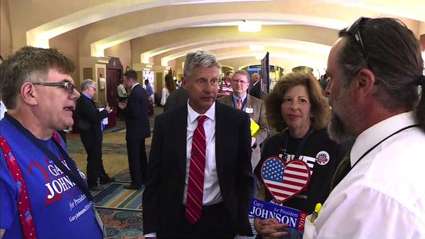 Libertarian presidential candidate and former New Mexico Gov. Gary Johnson talks with supporters at the Libertarian National Convention in Orlando, Florida, on May 27, 2016.