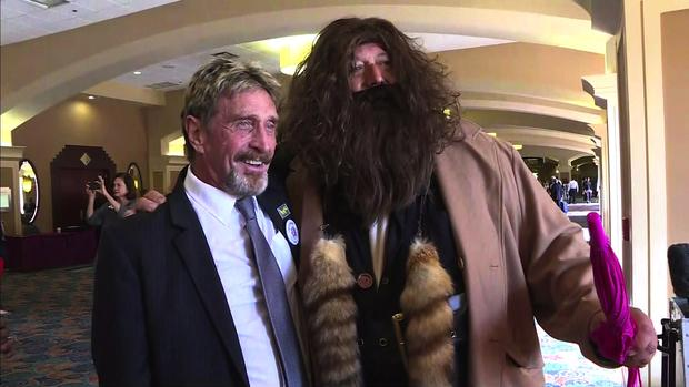 Libertarian candidate John McAfee poses with a man dressed as Hagrid at the Libertarian National Convention in Orlando, Florida, on May 27, 2016.