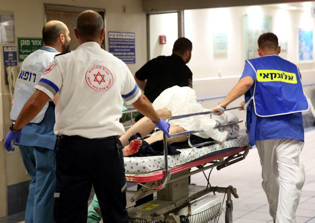 Injured person is taken into emergency room following shooting attack in center of Tel Aviv on June 8, 2016