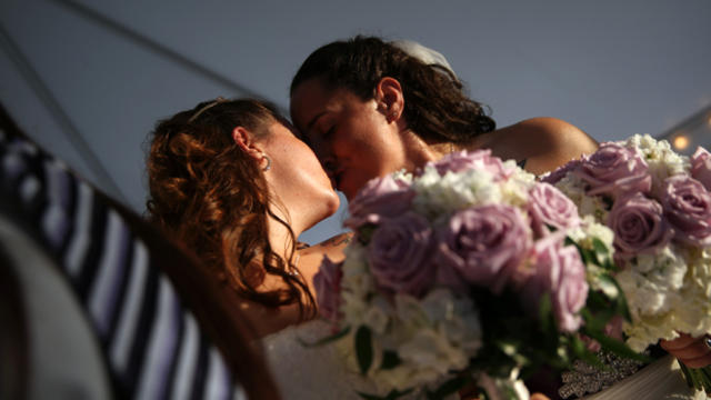 Melissa Adams, 32, right, and Meagan Martin, 30, kiss after their wedding ceremony on July 11, 2015, in Lexington, South Carolina.