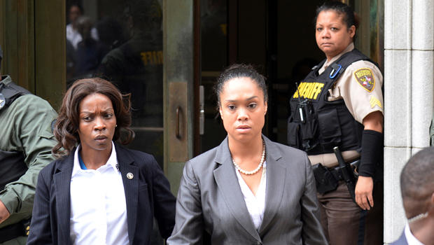 State's Attorney Marilyn Mosby, center, departs the courthouse in Baltimore, Maryland, on June 23, 2016, after Officer Caesar Goodson was found not guilty of all charges related to the death of Freddie Gray.
