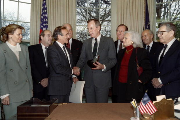 President George H. W. Bush receives the Elie Wiesel Foundation Humanity Award on March 18, 1991, in the Oval Office of the White House from Nobel laureate Elie Wiesel.