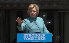 Clinton holds rally in front of shuttered Trump hotel