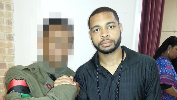 Micah Xavier Johnson, right, is seen in a photo obtained by CBS News.