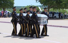 Thousands line streets as Dallas policemen laid to rest