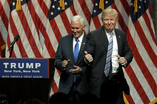 Republican presidential candidate Donald Trump points to Indiana Gov. Mike Pence after introducing Pence as his vice presidential running mate in New York City July 16, 2016.