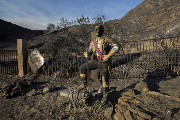 Burned pirate sculpture stands in a landscape scared by the Sand Fire on July 25, 2016, in Santa Clarita, California