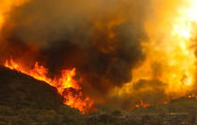 Explosive California wildfire prompts more evacuations