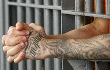 U.S. to reduce use of private prisons