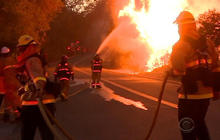 "California firefighters battling 80-foot ""walls of fire"""