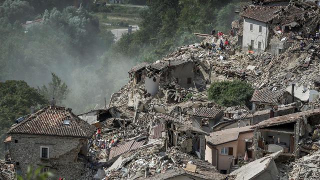Rescuers work following an earthquake in Pescara del Tronto, Italy, Aug. 24, 2016.