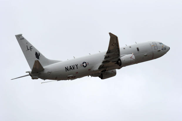 A U.S. Navy P-8 Poseidon aircraft flies out from Perth International Airport to assist with the international search effort trying to locate missing Malaysia Airways Flight 370 on April 16, 2014, in Perth, Australia.