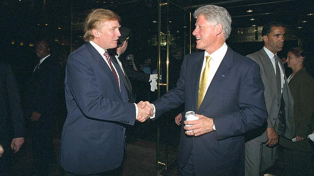 Donald Trump and President Clinton shake hands at a fundraiser at Trump Tower in New York on June 16, 2000.