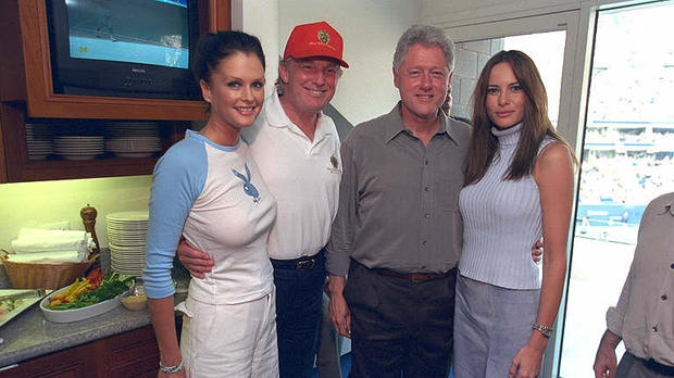 Donald Trump, President Clinton, Melania Knauss, right, who would later marry Trump, and Sports Illustrated swimsuit model Kylie Bax pose for a photo at the U.S. Open in Flushing, New York, on Sept. 8, 2000.