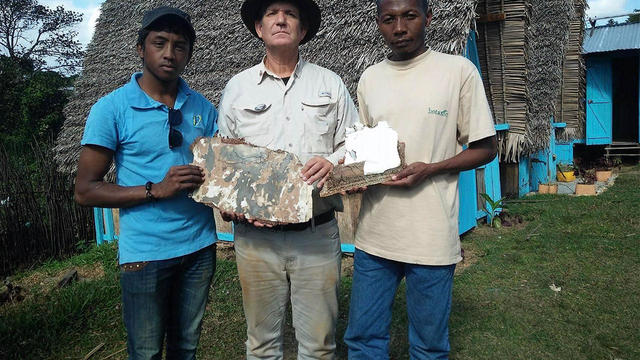 American wreckage hunter Blaine Gibson shows off pieces of suspected aircraft debris that he believes could be from missing Malaysia Airlines Flight 370