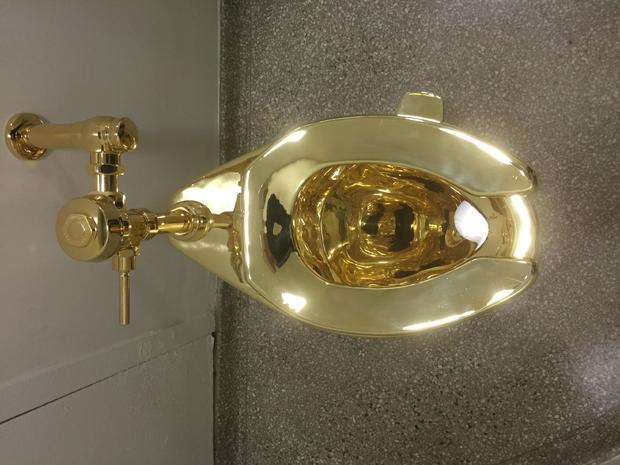 guggenheim-gold-toilet-gettyimages-605913518.jpg