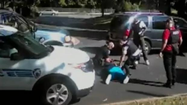 Keith Lamont Scott, 43, lies on the ground after he was shot by police in Charlotte, South Carolina, on Sept. 20, 2016, in this screen capture of video provided by attorneys for Scott's wife Rakeyia Scott.