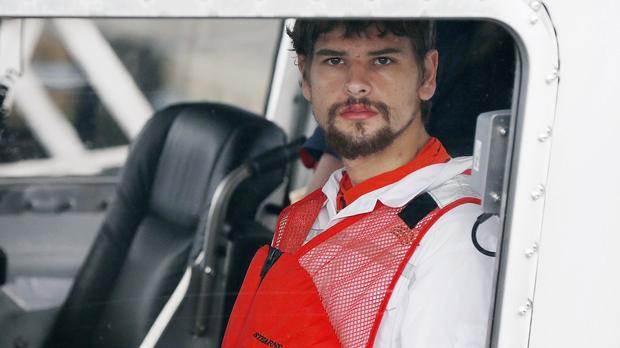 Nathan Carman arrives in a small boat at the U.S. Coast Guard station in Boston Sept. 27, 2016. Carman spent a week at sea in a life raft before being rescued by a passing freighter.