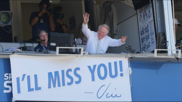 Los Angeles Dodgers broadcaster Vin Scully waves to the crowd during a game against the Colorado Rockies at Dodger Stadium in Los Angeles Sept. 25, 2016.