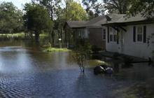 Cresting rivers in North Carolina threaten to cut off communities