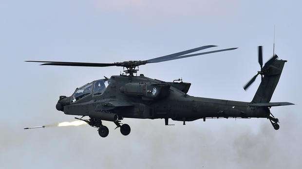 A U.S. AH-64 Apache helicopter fires rockets during a joint live firing drill between South Korea and the U.S. at the Seungjin Fire Training Field in Pocheon, South Korea, Aug. 28, 2015.