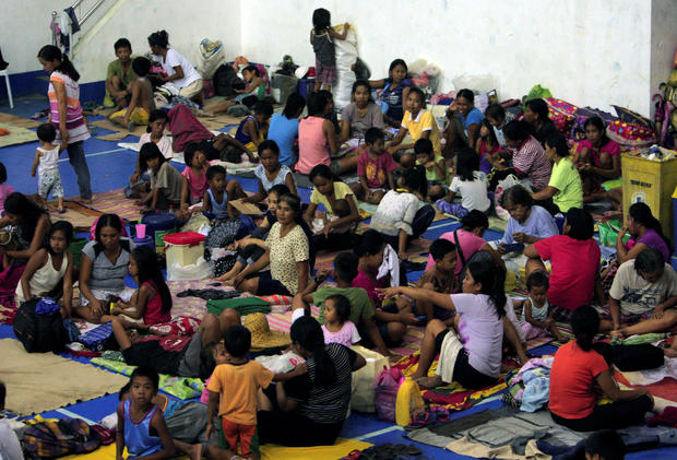 Evacuees from the coastal villages take shelter inside an evacuation center as Typhoon Haima approaches in Alcala, Philippines, Oct. 19, 2016.