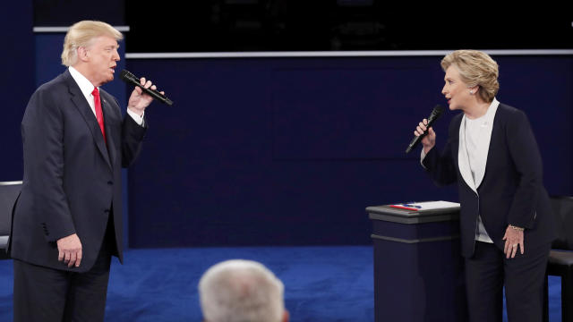 Republican presidential nominee Donald Trump and Democratic presidential nominee Hillary Clinton speak during their presidential town hall debate at Washington University in St. Louis, Missouri, Oct. 9, 2016.