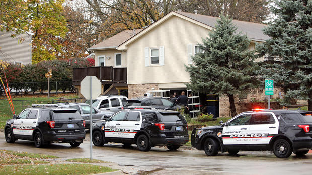 "Urbandale police officers gather outside the home of Scott Michael Greene, the suspected gunman of two police officers who were shot and killed in separate attacks described as ""ambush-style"" in Urbandale and Des Moines, Iowa, Nov. 2, 2016."