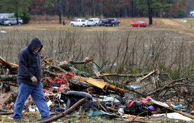 Deadly storm system rips through South