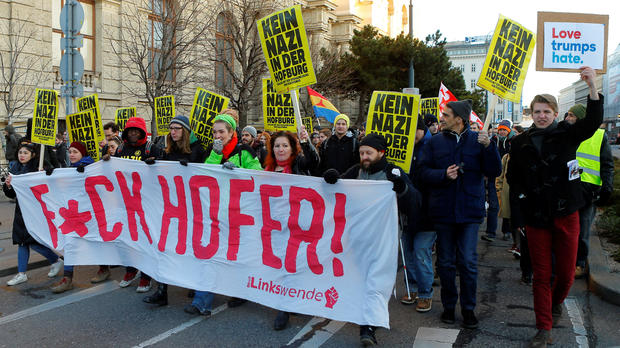 "Protesters holding posters that read ""No Nazi inside Hofburg palace"" demonstrate against Austrian presidential candidate Norbert Hofer in Vienna, Austria, Dec. 3, 2016."