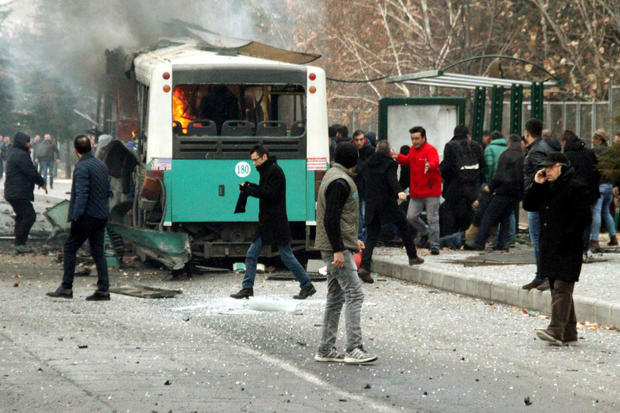 People react after a bus was hit by an explosion in Kayseri, Turkey, Dec. 17, 2016.