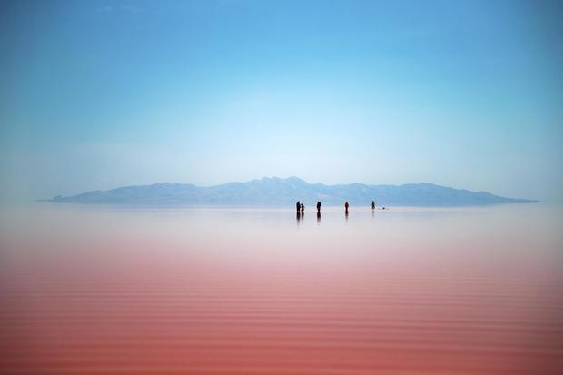 Iranians spend time in Urmia Lake near Urmia, northwestern Iran, Aug. 26, 2016.