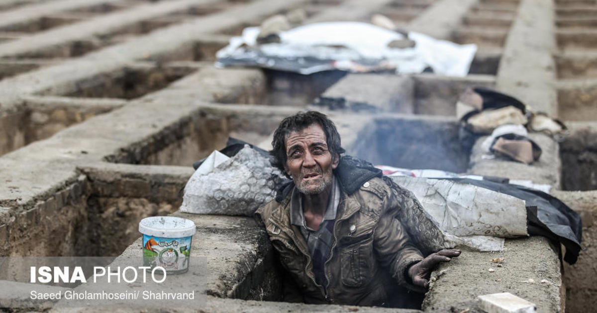 pictures of homeless sleeping in empty graves shock iran cbs news