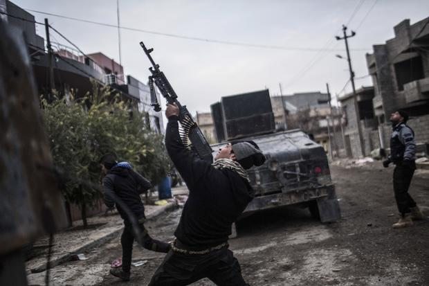 A member of the Iraqi special forces shoots his machine gun against an Islamic State of Iraq and Syria militant drone in the al-Barid district in Mosul, Iraq, Dec. 18, 2016.