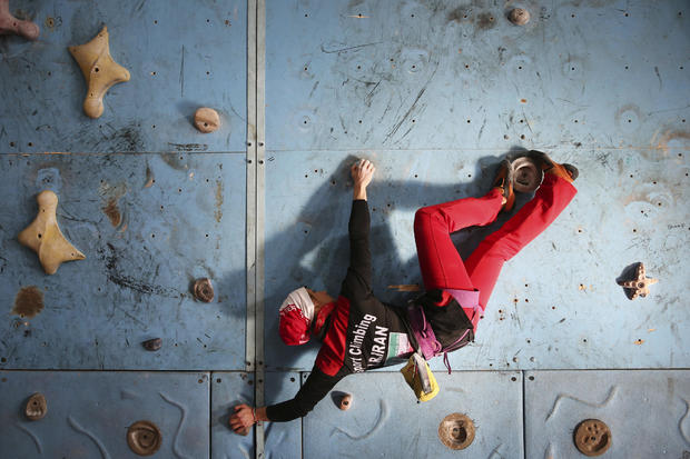 Iranian rock climber Farnaz Esmaeilzadeh scales a climbing gym in the city of Zanjan, some 207 miles west of the capital Tehran, Iran, Jan. 18, 2016. Esmaeilzadeh, 27, who has been climbing since she was 13, has distinguished herself in international competitions despite the barriers she faces as a female athlete in conservative Iran.