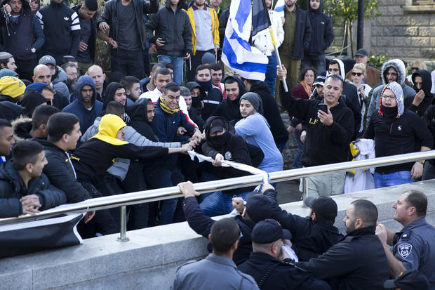 Right-wing supporters of Israeli soldier Sgt. Elor Azaria scuffle with police outside the Israeli military court in Tel Aviv, Israel, Jan. 4, 2017.