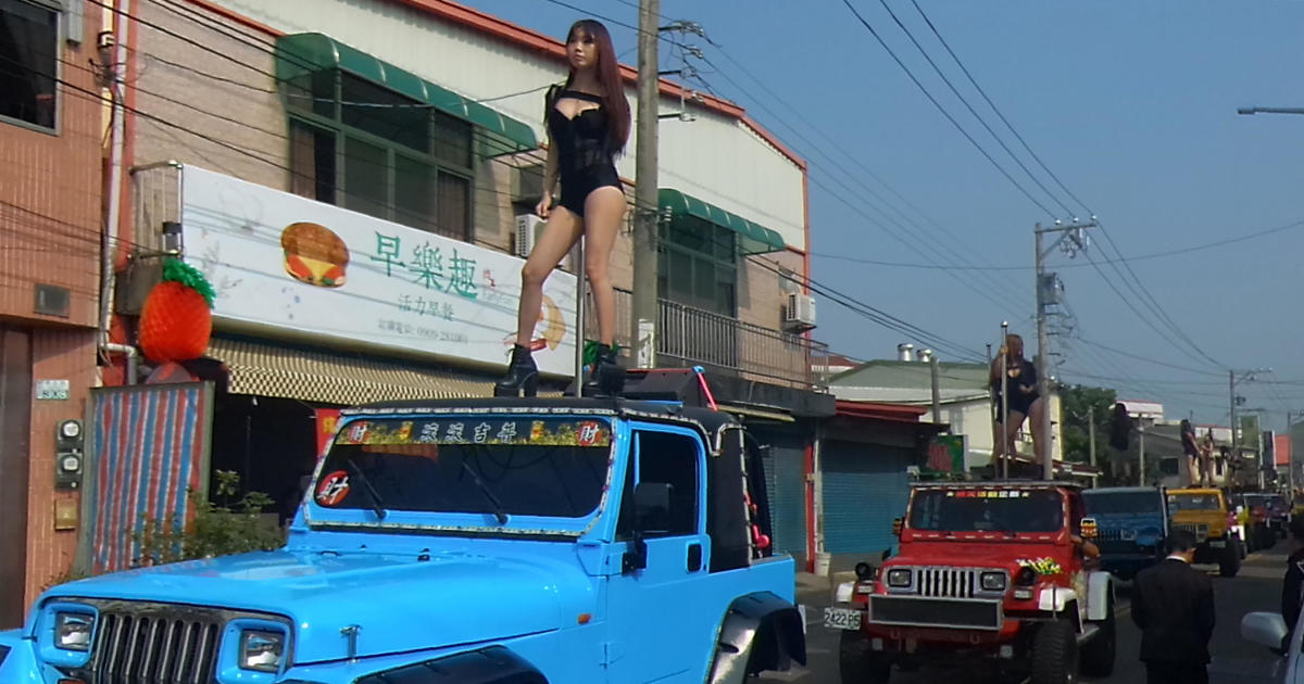 Taiwan politician funeral has pole dancers on Jeeps in parade with marching band