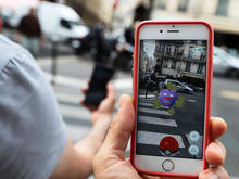 pokemon-go-paris-getty-583521326.jpg