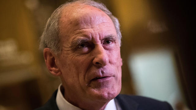 Sen. Dan Coats, R-Indiana, speaks to reporters at Trump Tower Nov. 30, 2016, in New York City.
