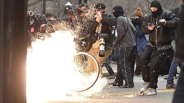 A police flash-bang grenade explodes as officers clash with protesters after the inauguration of President Trump on Jan. 20, 2017, in Washington.