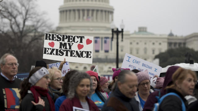 Demonstrators march past the U.S. Capitol during the Women's March on Washington in Washington Jan. 21, 2017.