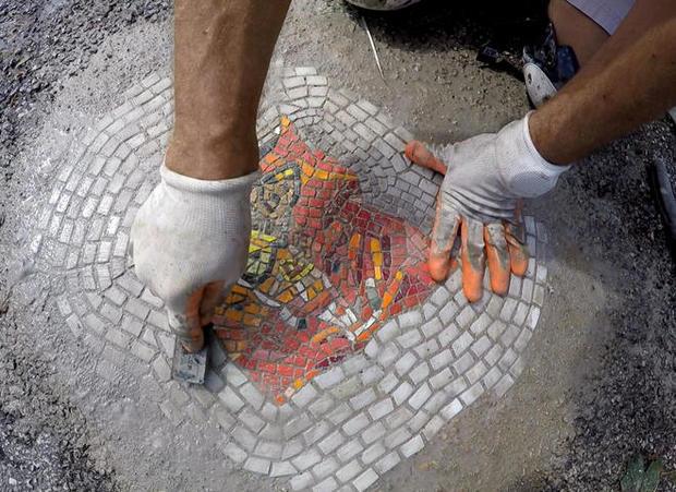 jim-bachor-working-on-pothole-mosaic-a-promo.jpg