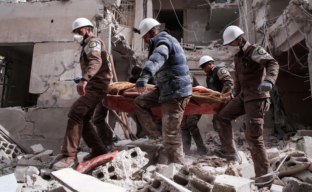 Syrian civil defense volunteers, known as the White Helmets, search for survivors following a reported government airstrike on the rebel-held neighborhood of Tishrin, on the northeastern outskirts of the capital Damascus, on Feb. 22, 2017.