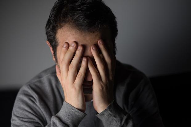 unhappy, sad, glum, man, sofa, lonely, depressed, stock, 4x3