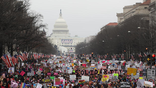 Women march across United States as Trump touts gains